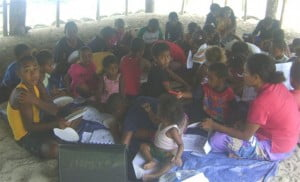 Community children participating in marine education activity