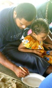 Dad Pita with 3yr old Sala busy colouring